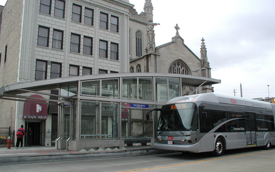 A bus at the stop picking up people in Chicago