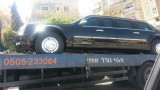 Obamas limousine being towed